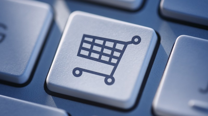 Symbolic icon of a shopping cart on a computer keyboard for online shopping